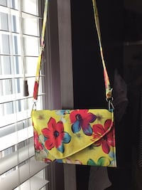white, green, and red floral crossbody bag