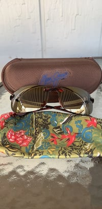 Brown Maui Jim's MJ sport with case and protective sleeves Mountain View, 94043