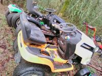 white and yellow ride-on mower 2326 mi
