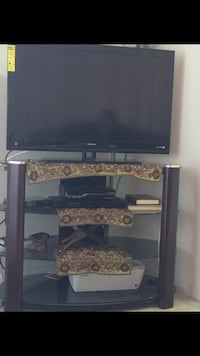Sharp flat screen tv with tv stand Edmonton, T6L 5S4