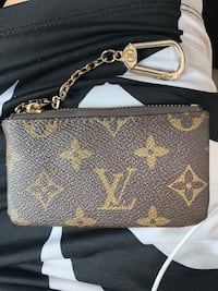 brown and black Louis Vuitton leather wristlet Manassas, 20109