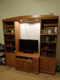 brown wooden TV hutch with flat screen television Cocoa Beach