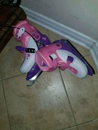 two pairs of pink and purple inline skates 704 km