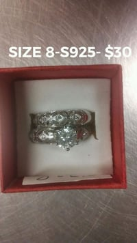 silver-colored clear gemstone studded rings with box