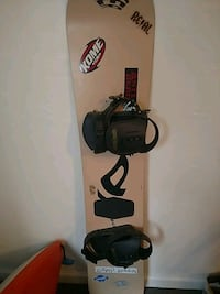 black and red snowboard with bindings