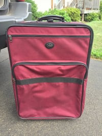Red and black luggage bag