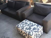 Gray fabric 2-seat sofa plus gray arm chair and floral ottoman. Sold as a set for $350