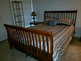 Queen bed with mattress and armoire