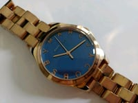 round gold-colored watch Vancouver, V6E 4T1