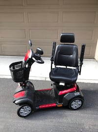 red and black mobility scooter 2395 mi