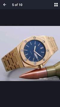 round gold-colored analog watch with link bracelet 15521 km