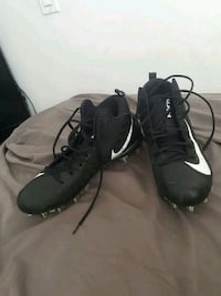 pair of black Nike cleats Surrey, V3W 3N1