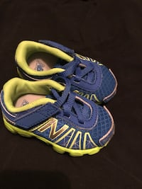 pair of blue-and-green Nike running shoes Riverdale, 30274