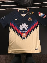 blue, red, and white Huawei The Home Depot CA jersey