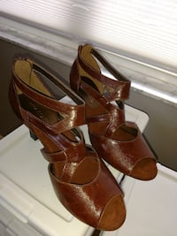 pair of brown leather open-toe ankle strap heel sandals