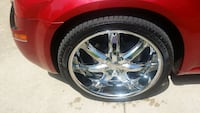 "chrome 22"" 7 spoke car wheel with tire"