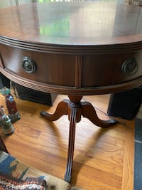 Mohogany drum table- antique . Two small drawers in table .solid wood Reston, 20191