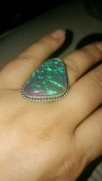 silver-colored and green gemstone ring Montreal, H8T