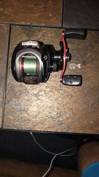black and red fishing reel Oxford, 19363