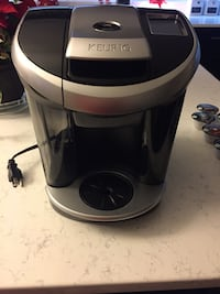 white and black Keurig coffeemaker 2 km