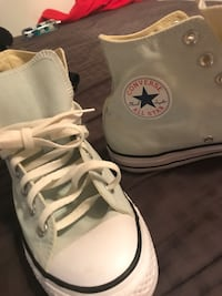 Pair of light blue converse high top sneakers