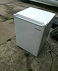 white and black compact refrigerator