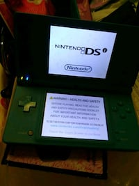 black Nintendo DS with game cartridge Vancouver, V6Z 0A1