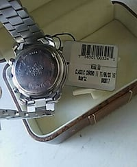 round silver watch with silver link strap Toledo, 43613