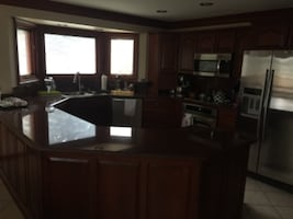 Lafata kitchen cabinets and cherry granite/ matching kitchen table