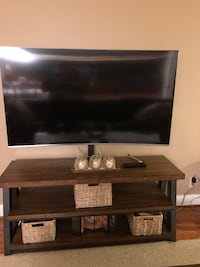 black flat screen TV; brown wooden TV stand Mc Lean, 22102