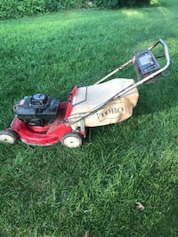 Red and black push mower Gainesville