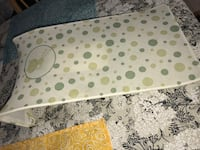 baby's white, beige, and green round print bather