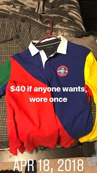 blue, red, and yellow polo shirt