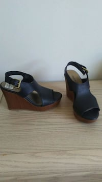 pair of black open-toe wedge sandals Winnipeg, R2K 0X3