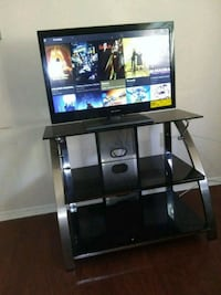 black flat screen TV; black TV stand District Heights, 20747