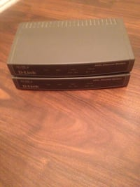 two gray D-Link modem's missing power cords easily bought Toronto, M4G