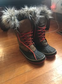 pair of black-and-red leather fur-lined duck boots