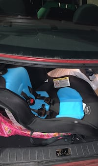 Baby stuff: a forward car seat for a toddler and a breast pump