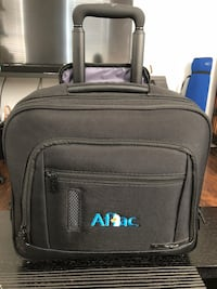 black and gray travel luggage 1201 mi