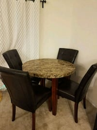 Round table with 4 brown leather chairs  Frederick, 21703