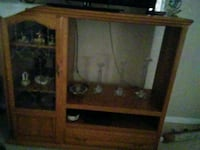 brown wooden TV hutch with flat screen television Henderson, 89074