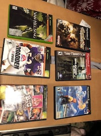 Three Xbox games and three PlayStation games in there boxes Danbury, 06811