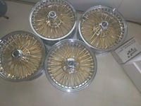 four brass-colored multi-spoke vehicle wheel set Redford Charter Township, 48239