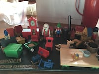 Santa's workshop. Wooden and plastic houses furniture Santas workbench at Cetera. Items are about 1 to 2 inch scale.