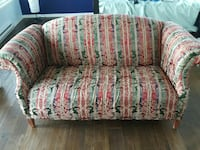 white, red, and green floral leather padded sofa