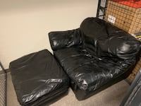 black leather tufted sofa chair