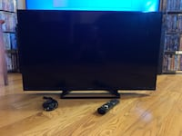 black flat screen TV with remote New York, 11203