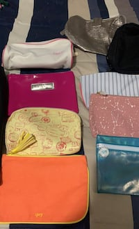 Several cosmetic bags and larger tote bag