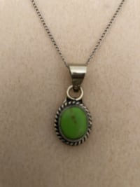 Silver necklace w/ green semi-precious gem stone pendant