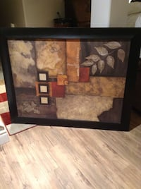 beige, brown, and black cubism painting with black frame